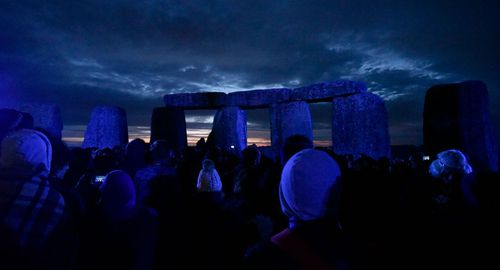 The northern summer solstice attracts hundreds of people to Stonehenge.