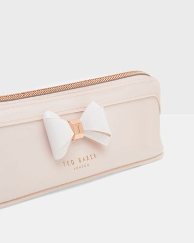 """<a href=""""http://www.tedbaker.com/au/Womens/Gifts/Gifts-for-her/ALISTER-Curved-bow-pencil-case-Mid-Pink/p/133424-XMID-PINK"""" target=""""_blank"""">Ted Baker Curved Bow Pencil Case, $49.95.</a>"""