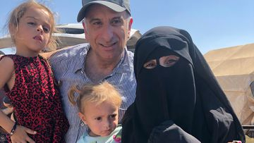 Kamelle Dabboussy with his daughter Mariam Dabboussy and her daughters Aisha and Fatema in al-Hawl camp.
