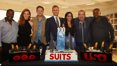 """Suits"" stars Wendell Pierce, Sarah Rafferty, Patrick J. Adams, Gabriel Macht, Meghan Markle, Rick Hoffman and Dulé Hill celebrate the show's 100th episode. Picture: Getty"