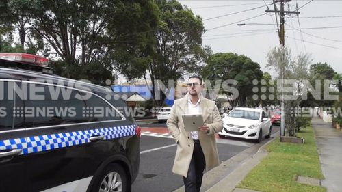 The property developer was glued to his iPad. Picture: 9NEWS