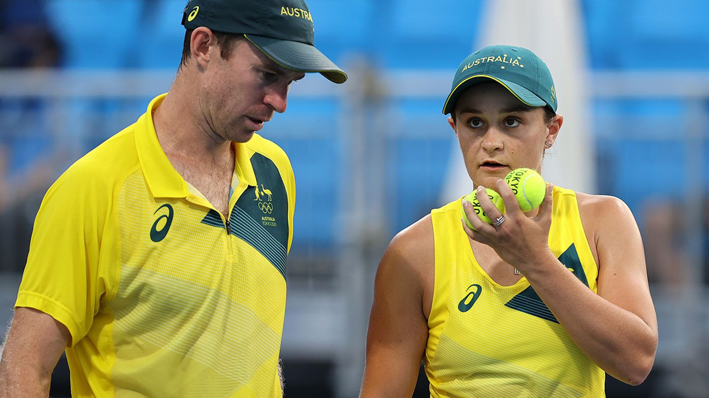 Barty closes in on medal after tense win