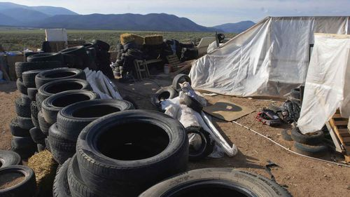 Tyres form a barrier around the New Mexico compound.