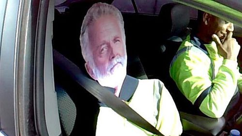 Driver busted using cutout of beer ad actor to cheat carpool lane