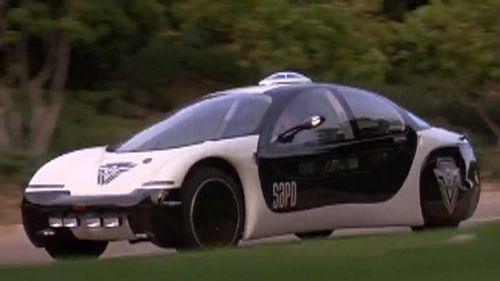 The driverless Mercedes bears an uncanny resemblance to a vehicle in the 1993 sci-fi film Demolition Man. (Silver Pictures/Warner Bros.)