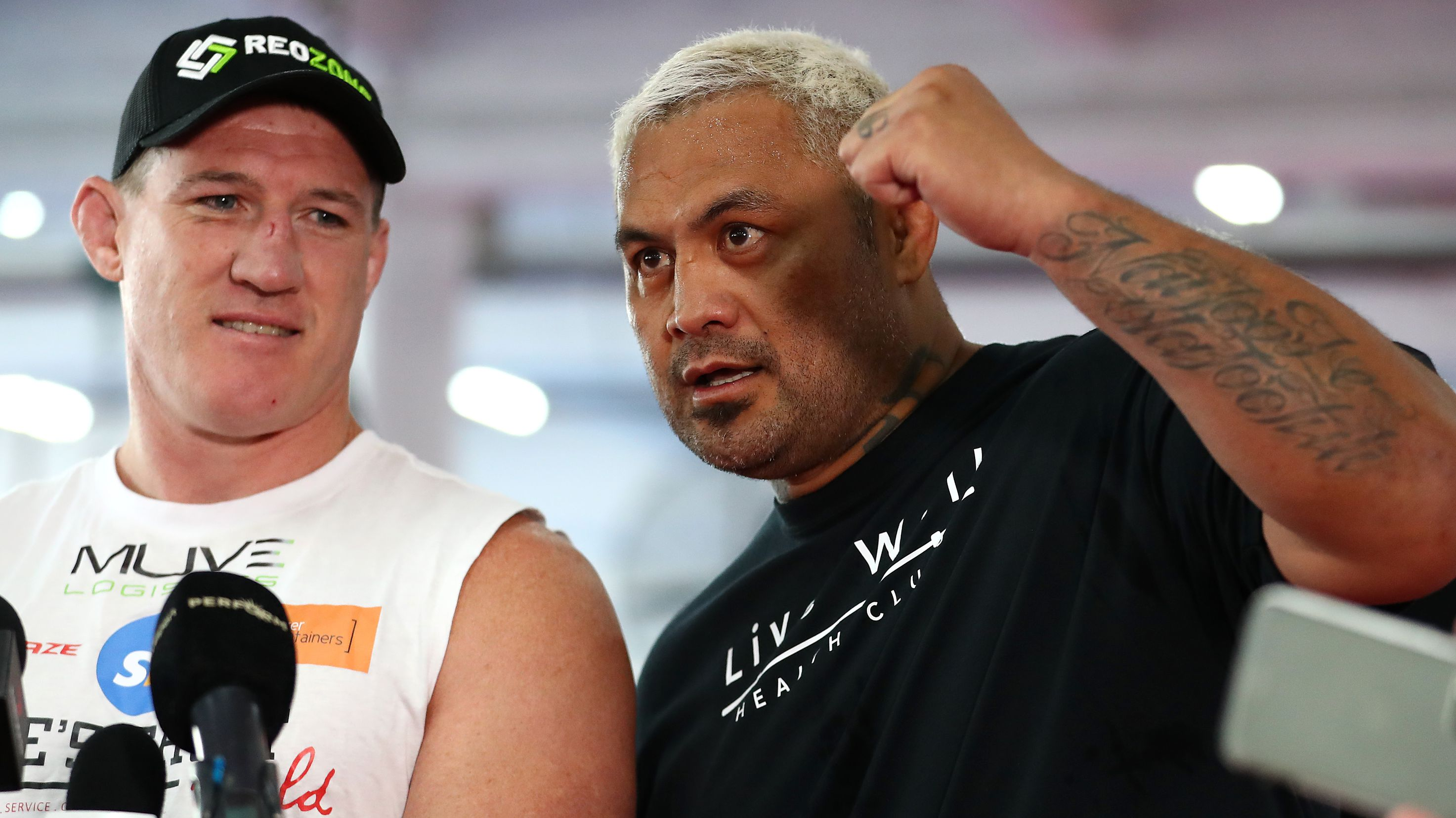 Mark Hunt interjects Paul Gallen during a media opportunity.