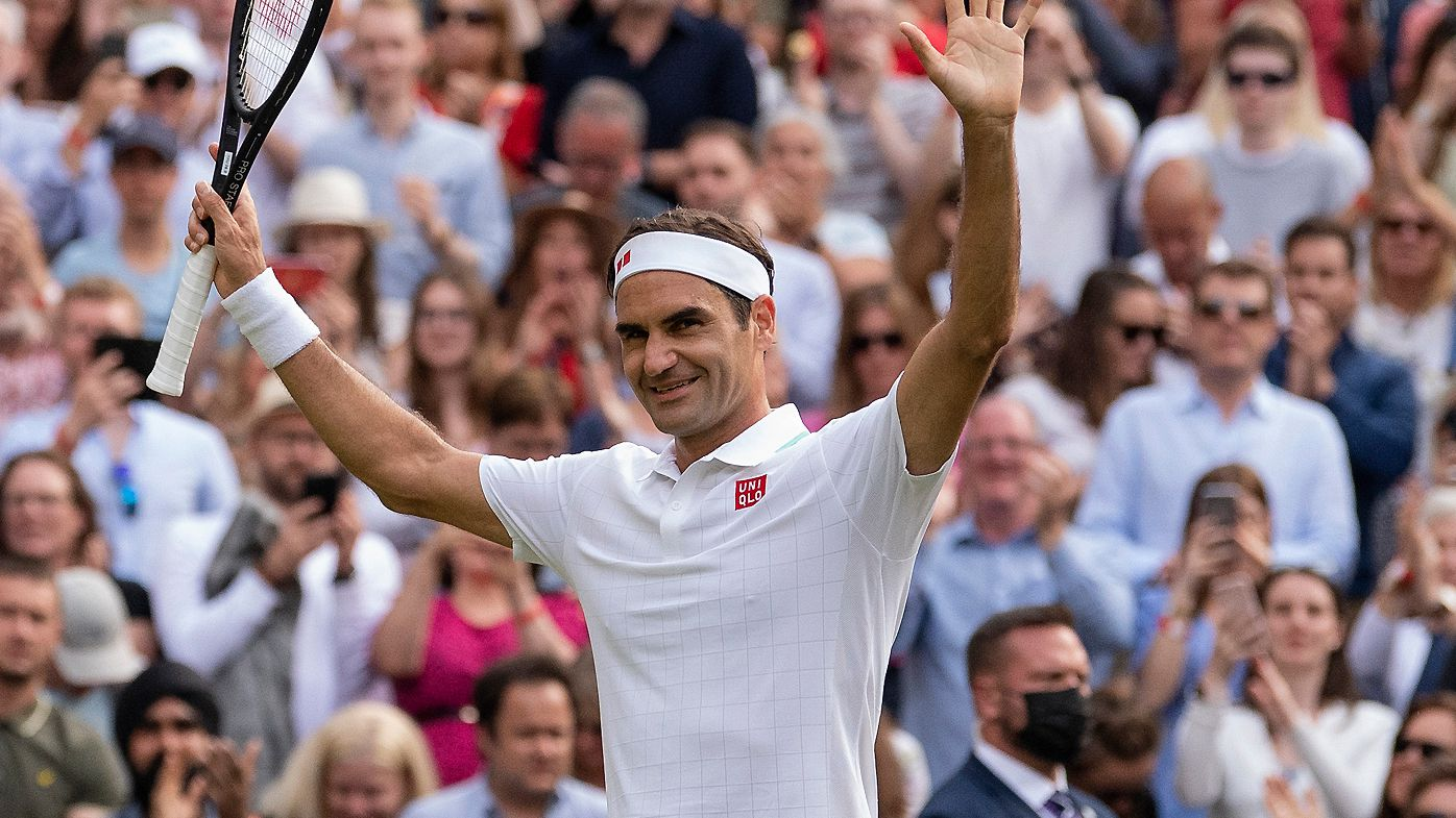 Roger Federer celebrates match point in the second round men's singles match against Richard Gasquet