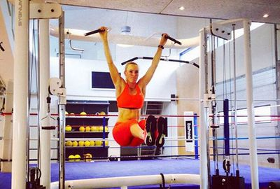 Danish tennis star Caroline Wozniacki sweats it out in the gym.