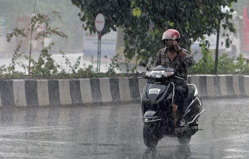 The weather department has issued warnings of heavy rainfall and gusty winds on Wednesday for Mumbai, Thane, Palghar, Raigad, Ratnagiri and Sindhudurg districts. (Photo by Satyabrata Tripathy/Hindustan Times via Getty Images)