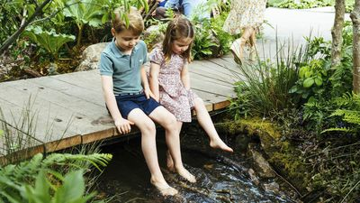 Prince George and Princess Charlotte play in their mother's Chelsea Flower Show garden