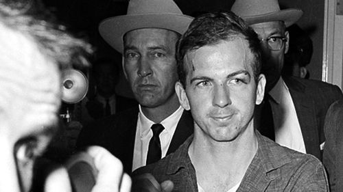 Lee Harvey Oswald at police headquarters in Dallas, Texas. (AAP)
