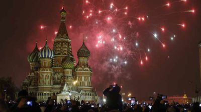 Partygoers snap up photos of the fireworks over St Basil's in Red Square, Moscow.