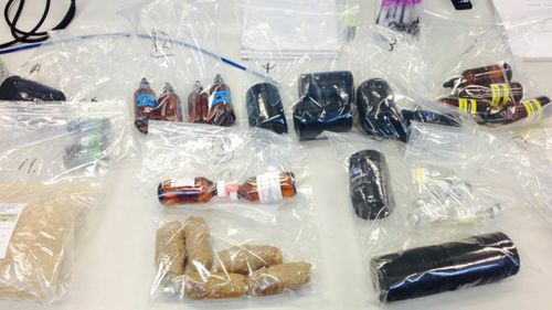 Queensland police uncover 3000 steroid capsules after raids of supplement stores and personal trainers' homes