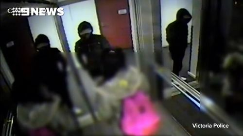 CCTV shows the suspect and his victim inside the apartment building elevator.