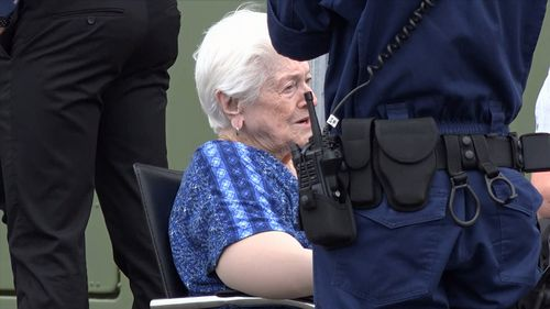 A 90-year-old woman was being assisted out of a Nissan Pulsar when the man confronted the pair with a knife.