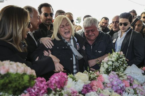 Ms Basaran's father Huseyin Basaran and other family members weep at her funeral. (Getty)