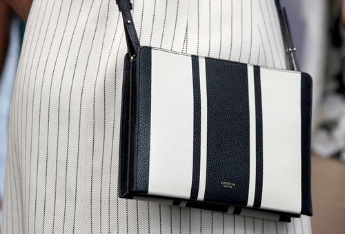 Meghan carried a bag by Australian brand Oroton. (PA/AAP)