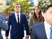 Canterbury Bankstown Bulldogs NRL player Adam Elliott (second left) arrives at the Downing Centre Court in Sydney on obscene exposure charges.
