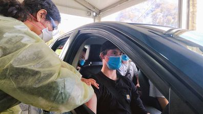 A P-plater gets his coronavirus vaccine at the drive-in hub at Werribee.
