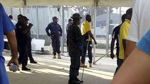 Police enter the detention centre on Thursday, ratcheting pressure on more than 300 asylum seekers to abandon the decommisioned camp. (Refugee Action Coalition/AP)
