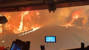 Firefighters trapped in a tunnel of fire during NSW bushfires. The crew escaped unharmed.