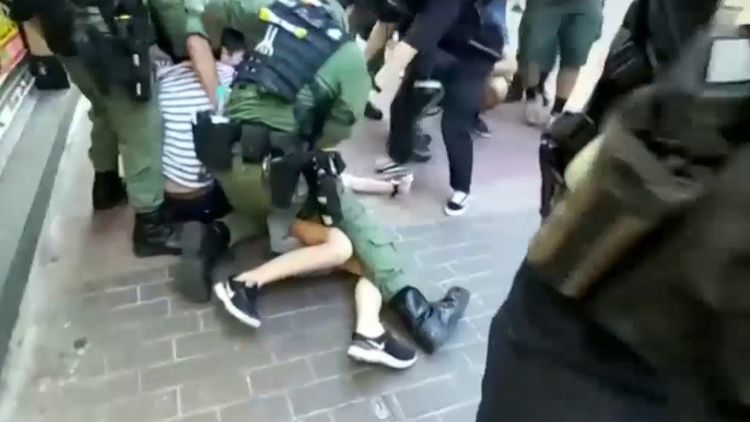 Hong Kong police criticised for tackling girl to ground during protests