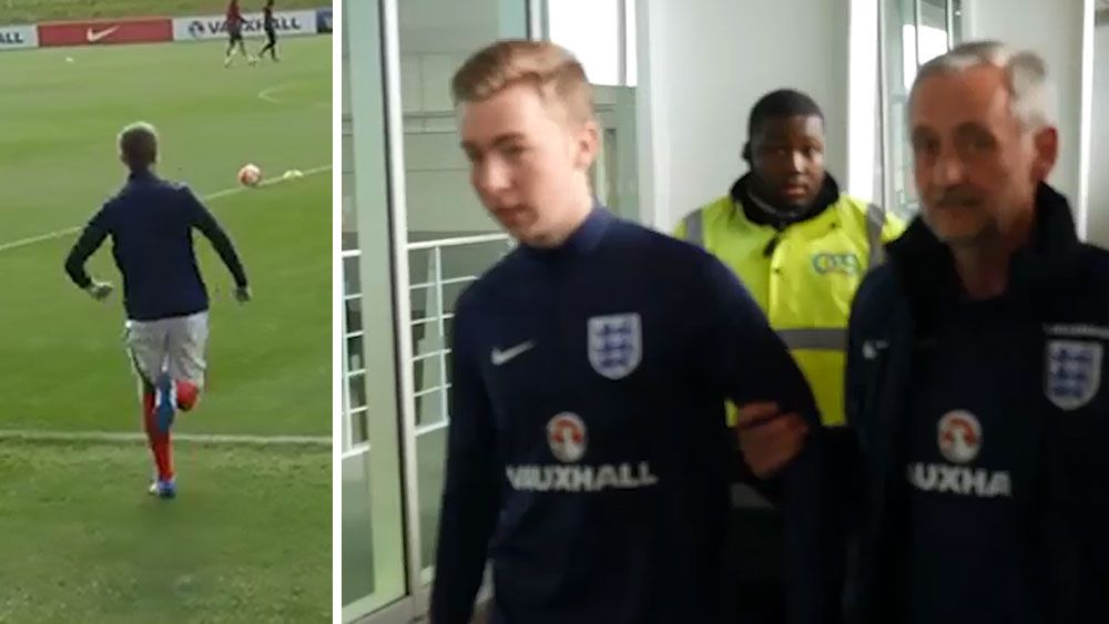 Fan intrudes on England team