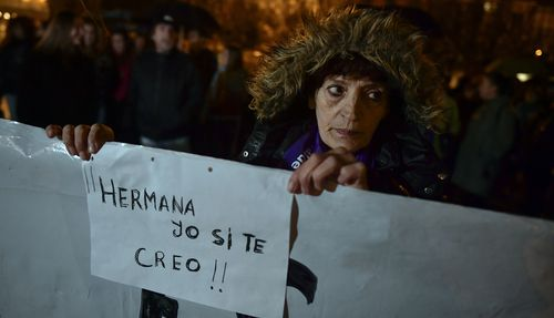 A woman holds a sign reading ''Sister. I believe you'' as people gather at Plaza del Castillo square to a protest against sex assault, in Pamplona, northern Spain, Monday, Nov. 4, 2019.