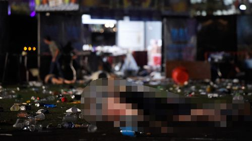 A body, which has been pixelated, lies on the ground amid rubbish at the concert. (Getty Images)