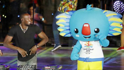 Sprinting champion Usain Bolt with mascot Borobi at the Gold Cost Commonwealth Games closing ceremony.