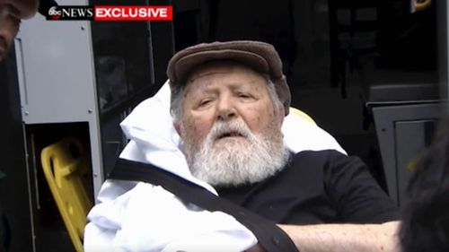 Former Nazi guard Jakiw Palij, 95, is carried by stretcher from his New York home as he is deported to Germany.
