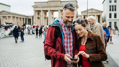 A couple taking a photo in Europe together.