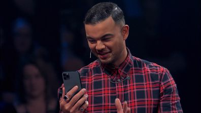 Guy stunned the group when he picked up his phone and dialled Michael Buble