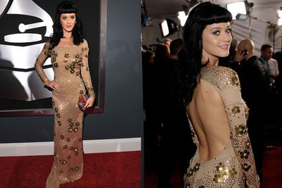 The back of Katy's dress is just <I>so</I> much better than the front...which is probably why her over-the-shoulder pose was on overdrive at the 2010 Grammys. <br/><br/>PS. Stop making that fugly fringe work KP, it's never going to.