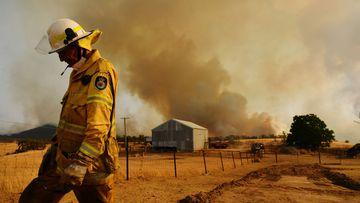 A Rural Fire Service firefighter Trevor Stewart views a flank of a fire on January 11, 2020 in Tumburumba, Australia