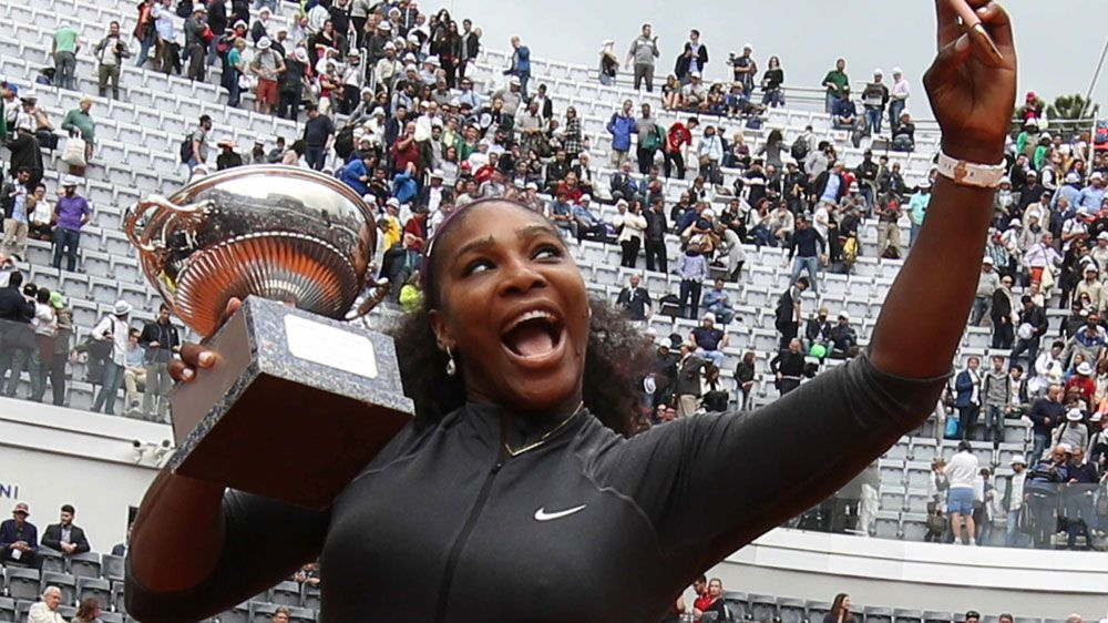 Serena snaps a selfie with her trophy.(AFP)