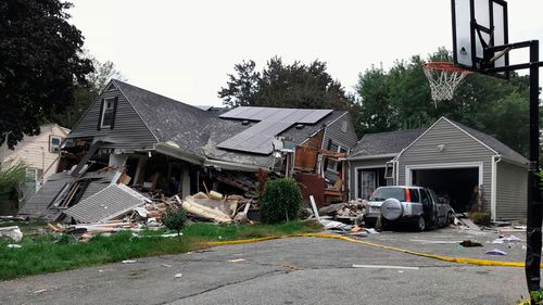 A house is destroyed in Lawrence after a series of gas explosions in the area.