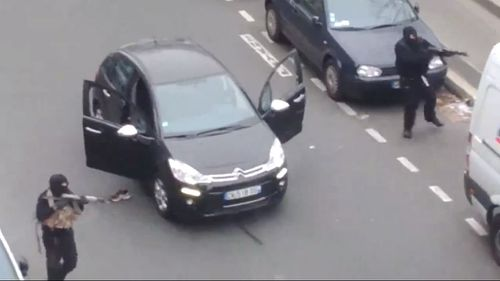 The gunmen outside the Charlie Hebdo building. (Supplied)