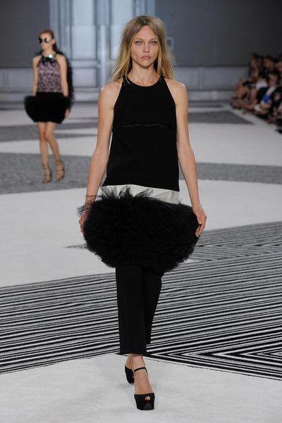 "<p>To celebrate 10 years in the business, designer Giambattista Valli&nbsp;treated guests at his couture show to larger-than-life earrings, intricate needlework and sweeping trains, the latter of which were described by fashion writer Tim Blanks as ""clearly quite taxing for the woman wearing the dress"". Valli has been known to use more than 350 metres of fabric in a single skirt to create his remarkable confections, and his exquisite craftsmanship has made him a red carpet favourite of Amal Clooney, Diane Kruger and a host of other stylish celebrities.</p>"
