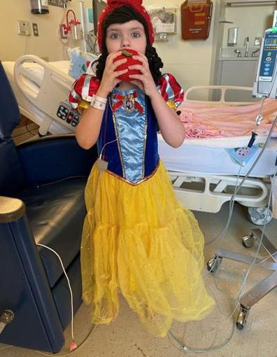 Young girl dressed as Snow White.