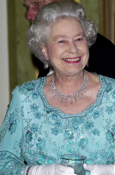 The Queen At The Dorchester Hotel Holding A Glass Before A Dinner Hosted By The President Of Poland During His State Visit To Britain (Photo: May, 2004)