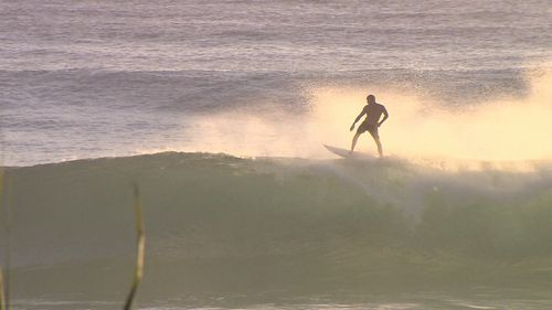 Mick Fanning was spotted surfing at Burleigh Heads this morning. (9NEWS)
