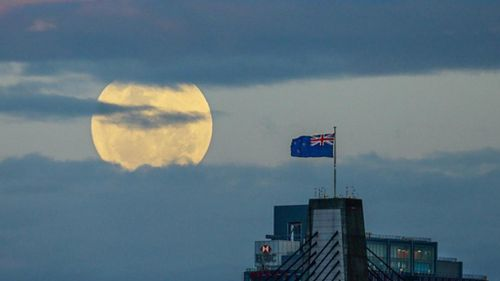 The super-sized moon peeked through the clouds behind Anzac Bridge in Sydney. (Instagram @dallas_kilponen)