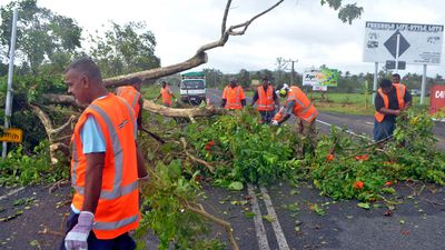 Fallen trees have cut power and blocked roads. (AAP Image/Naziah Ali, Mai Life Magazine)