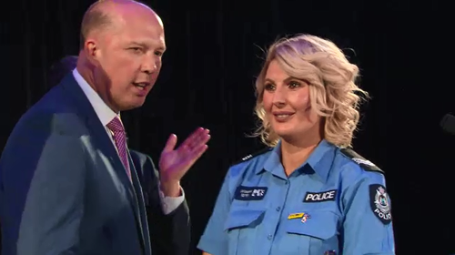 Home Affairs Minister Peter Dutton presented Sen Const Bochorsky with her award.