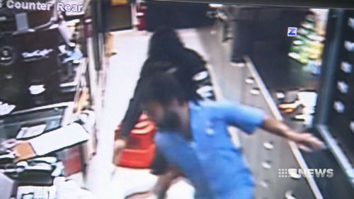 Mr Kumer was pushed across the Southport service station during the ordeal. (9NEWS)