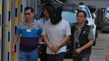 Hong Kong murder accused 'used inflatable ball to gas wife and daughter'
