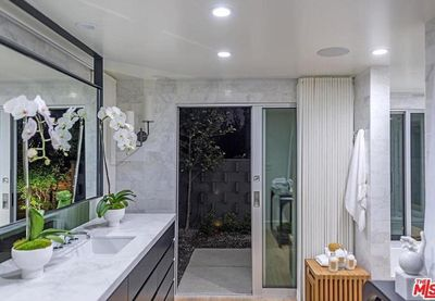Another bathroom with stunning marble bench tops and private outdoor area.