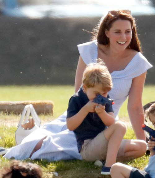 Prince George happily playing with a toy pistol in front of his mum at a polo match in Gloucestershire recently. Picture: Getty