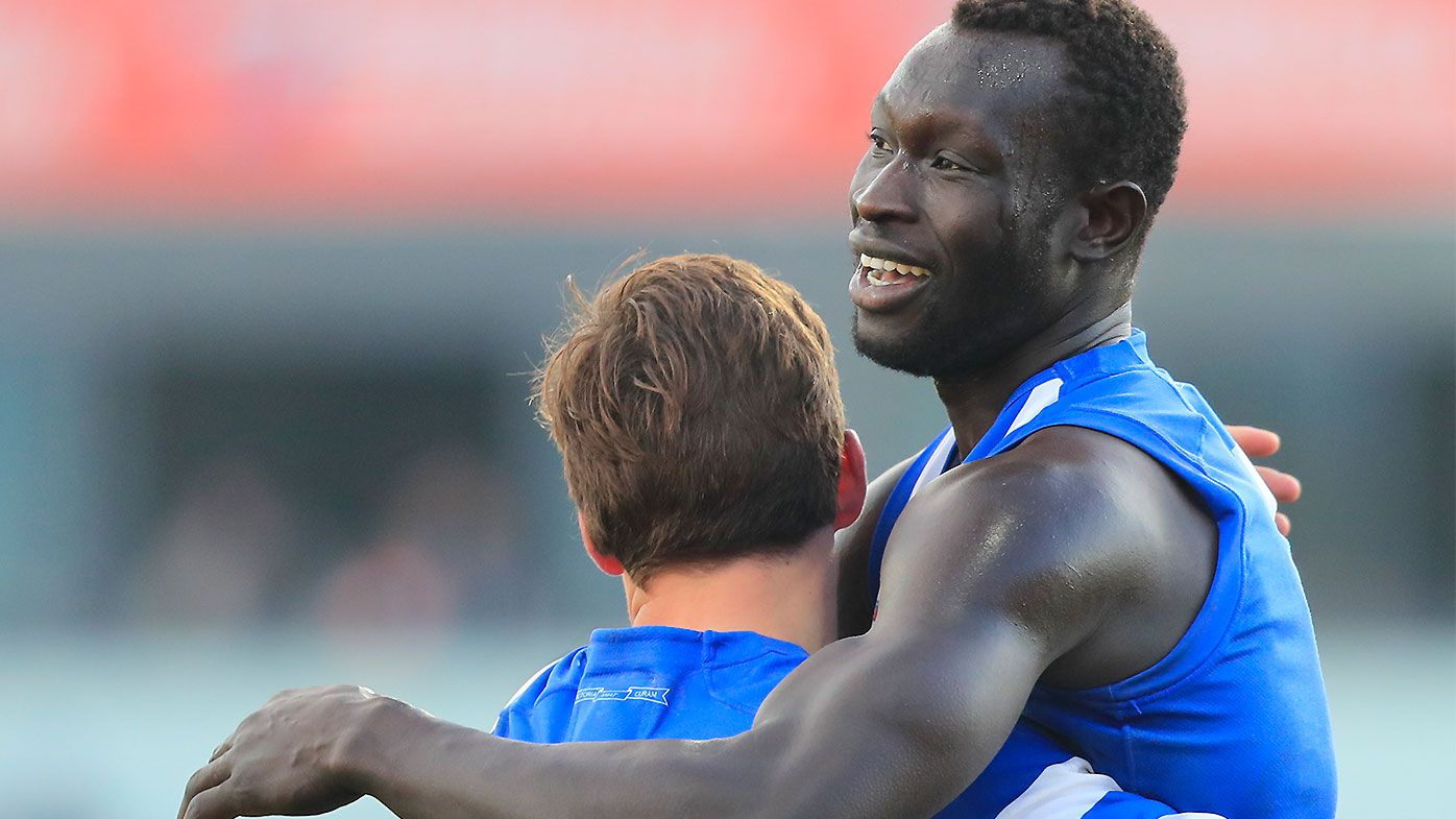 Inspirational Majak Daw training return cheered on by Kangaroos teammates